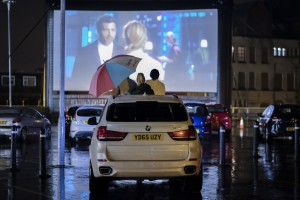 Customers enjoying Bridget Jones's Baby at drive-in cinema at Tesco Extr...